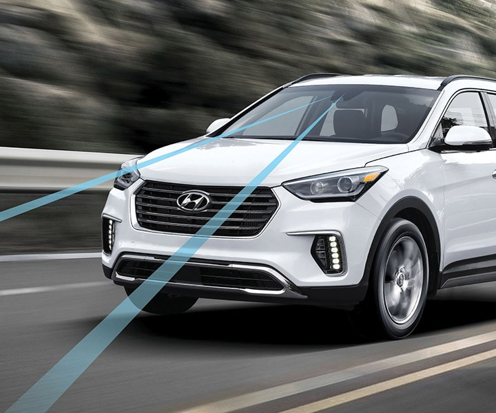 photo of white Hyundai Santa Fe XL 2018 SUV using the lane departure warning system