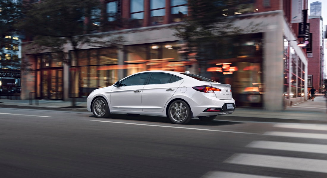 2020 Elantra in white driving on the streets