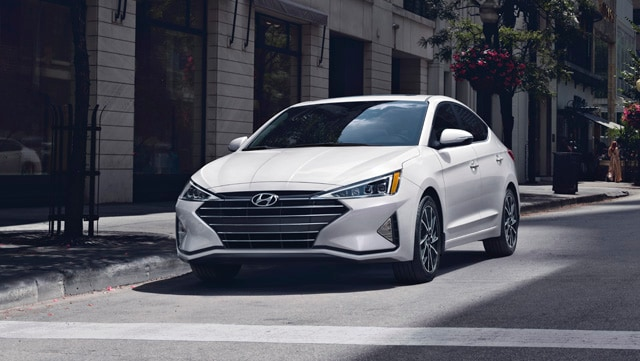 2020 Elantra driving on the road in white