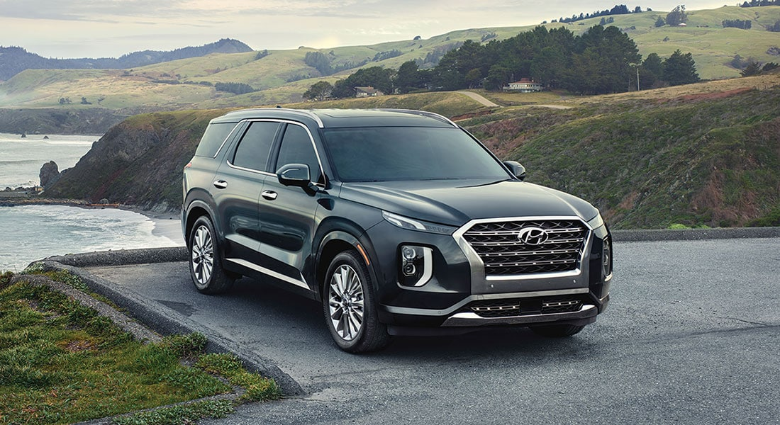 image of a parked forest green 2020 palisade