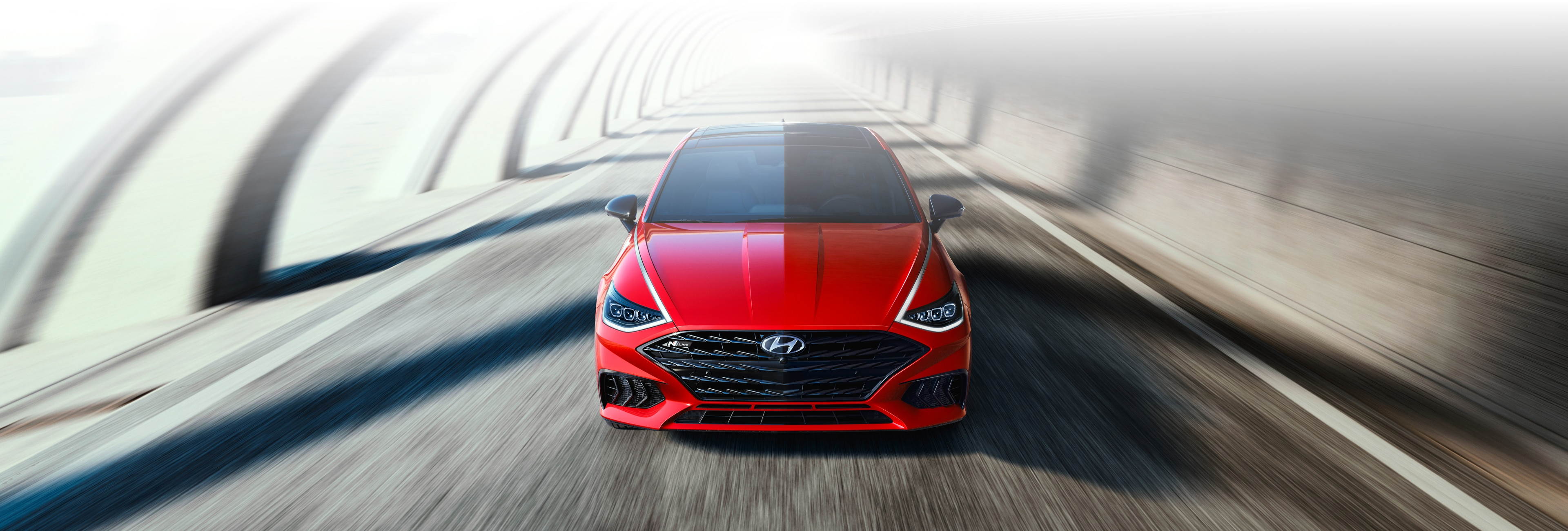 2021 Sonata N Line in red driving on the road